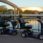 Rental Scooters at Disney Epcot in front of Test Track