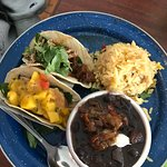Jerk Chicken taco and Brisket taco with black beans and rice