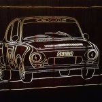Wooden wall panel, lit from behind, Škoda sports car