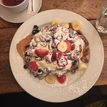 American Style pancakes with yoghurt, fruit and nuts.
