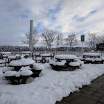 A snowy yet inviting outdoor seating area