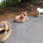 A few of the wooden sculptures that you will see climbing the hill.