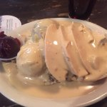 Turkey with mashed potatoes, gravy, stuffing and cranberries