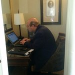 Husband working hard in his corner office in the Stanley Thompson room