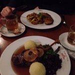Schnitzel with fried potatos and goose leg with potato dumplings and sauerkraut