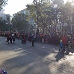 Families out and about on Paseo de la Reforma for a balloon parade, early on a Saturday