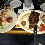 sirloin steak combo with grilled shrimps and potatoes