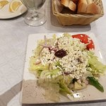 Greek Salad: Lettuce, Onions, Tomatoes, Cucumbers, Olives, Feta Cheese, And Homemade Dressing