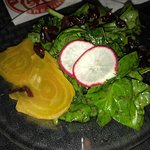 Spinach and kale salad with roasted golden beets