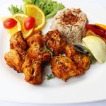 One of our best sellers , Shish taouk is a traditional marinated chicken shish kebab of Middle E