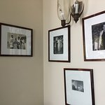 B&W photos line the walls; see who you recognize.