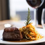 """Sirloin steak with """"migas"""" of cornbread and vegetables"""