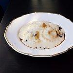 Confit duck ravioli, foie gras sauce, tapenade of mushrooms and truffle, sauté of seasonal green