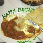 Chicken madras curry, with rice and naan