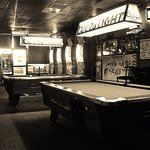 Two Pool tables and four dart boards on east side of room