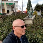 myself in front of bronze statue depicting Stations of the Cross