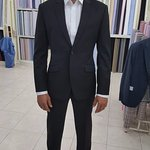 Slim fit 2 button black lounge suit.