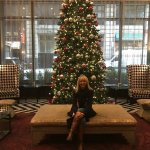 Janice by the Christmas tree in the hotel lobby