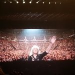 Brian May taking a selfie with the audience.