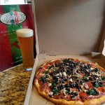 A classic combination, beer and pizza!