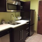 Kitchenette with microwave and fridge.