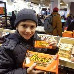 Comparing the regular Reese's to the 1 pound Reese's he bought!