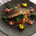 Sea bass with Roasted vegetable Couscous and edible flowers.