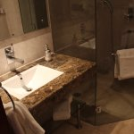Hairdrier, marble sink and glass shower
