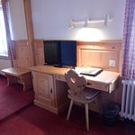 Small desk & TV in bedroom, to the left is the sitting room