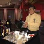 Raul at Los Gallos preparing our Mayan Coffee. He is the best!