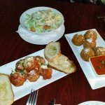 Appetizers. Meatballs, arancini and ceaser salad.