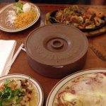 Combo plate...chili relleno, salsa verde enchilada, & pastor tacos and chicken/steak/shrimp faji