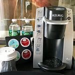 In room Keurig coffee brewers with Caribou coffee and complimentary bottled water