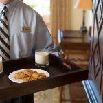 Butlers serve milk and cookies at turndown.