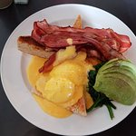Delicious eggs benedict with bacon spinach & avocado..sauce is their own too..& a man's size bre