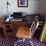 A King Suite with work desk and plenty of space.