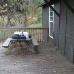 Table on back porch and view of the screened in area