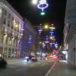 Street view in front of the hotel with Christmas lights.
