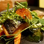 Oven baked salmon with potato-chives cream, asparagus and trout caviar