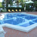 Pool 3 feet deep, limited loungers, no shade, driveway for deliveries