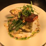 Salmon fillet with a pink peppercorn sauce