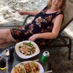 Enjoying delicious fish tacos and chicken salad on the beach.