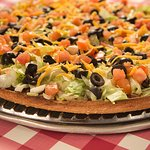 One of our signature pizzas is our taco pizza!