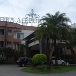 Front entrance of hotel, which is set back from the main road.