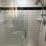 Large subway-tile shower with hand-held shower head. Awesome water pressure!!
