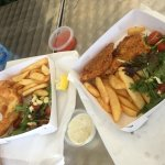 Left - gold fish and chips w. salad. Right - silver crumbed fish and chips w. salad.