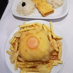 Omelette with rice, Francesinha with fries