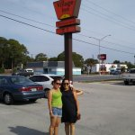 Friends in front of the Village Inn Sign!