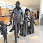 In the arrival hall where you purchase your tickets, statue of George Washington and his family