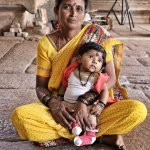 Lovely mother and baby in the temple
